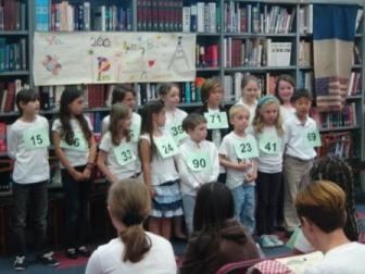 2009 Paris Spelling Bee finals: 2009 Paris Spelling Bee Contestants in the Gazelles group (7-9 year-olds) Left to right: Lily Lepage (15), Julia Connelly (66), Loic Lescoat (65), Niamh Howley (39), Gabriel Bugeaud (71), Ella Quainton (30), Emma Newman (84). Front row, left to right: Einin O'Donnell (33), Adria Niessner (24), Jack Souami (90), Louis Miller (23), Gabrielle Voiriot (41), Taeyon Kim (69)